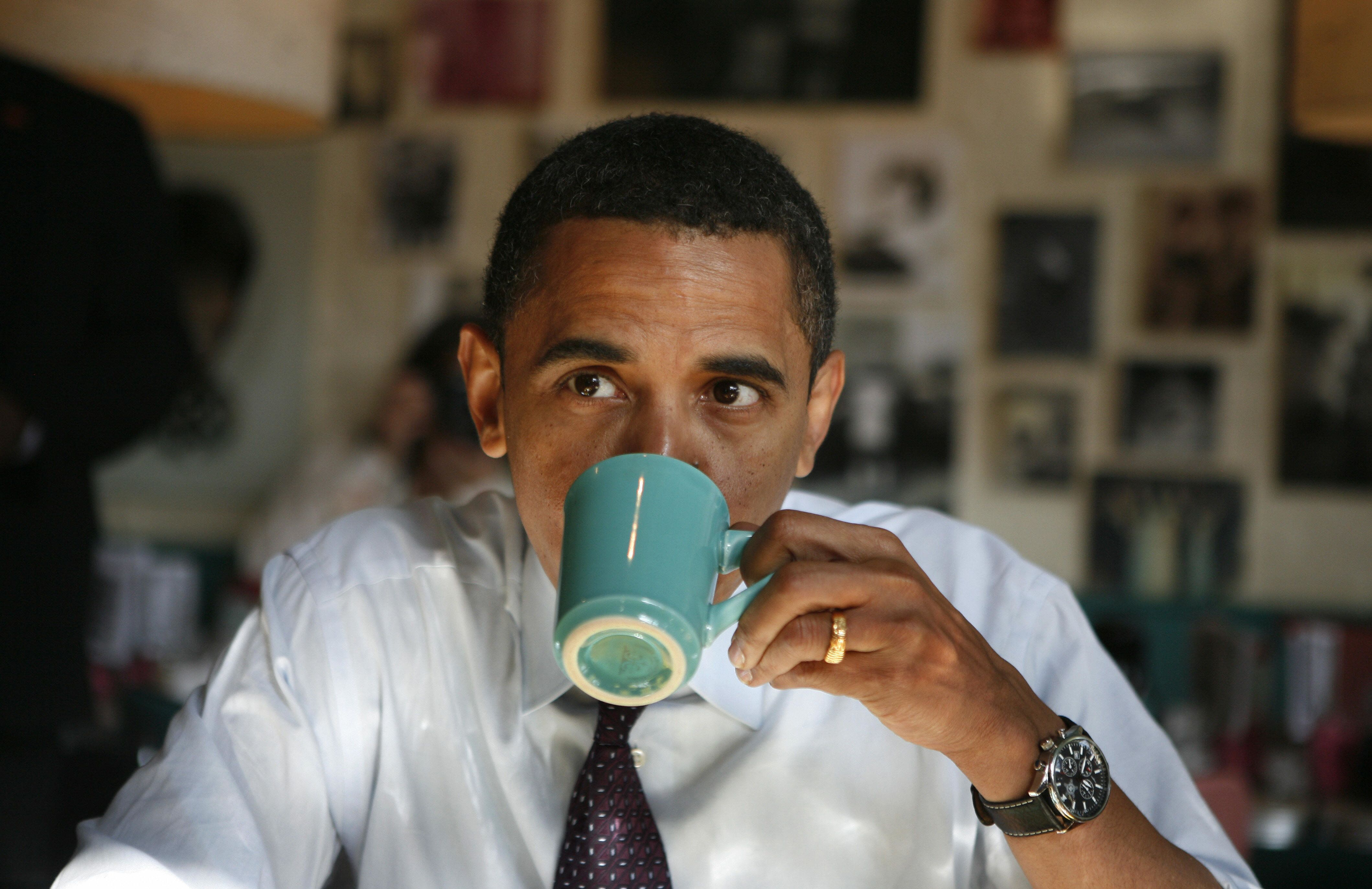 Democratic presidential candidate US Senator Barack Obama drinks coffee while having breakfast at Pamela's Diner in Pittsburgh, Pennsylvania,  April 22, 2008.  Polls opened in Pennsylvania's presidential primary Tuesday, with Hillary Clinton favored to win, but unlikely to overtake Barack Obama's overall lead in their marathon race for the Democratic nomination.    AFP PHOTO/Emmanuel Dunand (Photo credit should read EMMANUEL DUNAND/AFP/Getty Images)