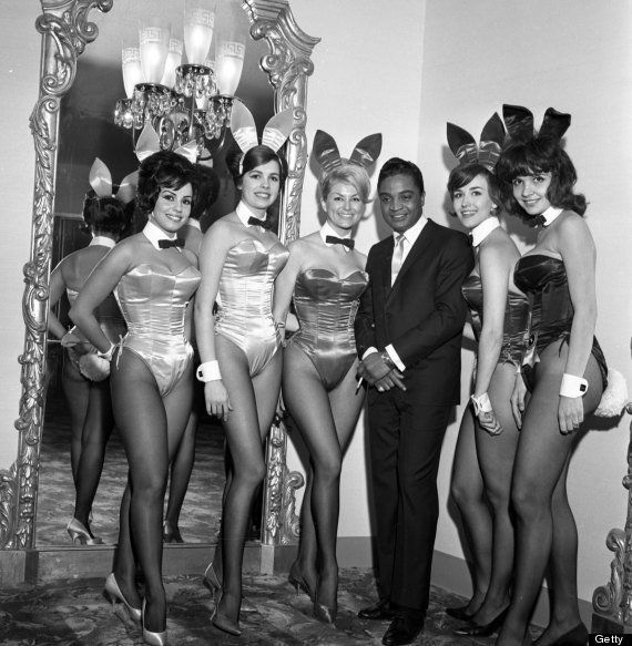 Rock and roll singer Jackie Wilson poses with a group of Playboy bunnies at a dinner for the Motion Picture Pioneers Association at the Playboy Club on November 19, 1962 in New York, New York.