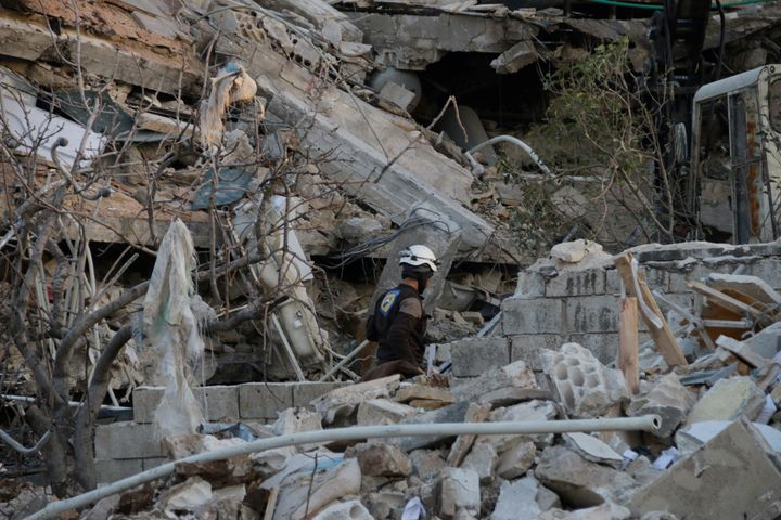 Rescue workers inspect the debris of a collapsed hospital in Maarat Numan. U.N. Secretary-General Ban Ki-moon said the attack
