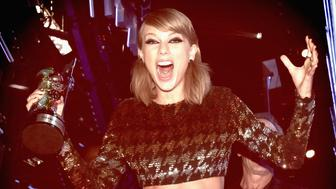 LOS ANGELES, CA - AUGUST 30:  (EDITORS NOTE: This image has been altered using digital filters.)  Recording artist Taylor Swift wins the Video of the Year Award for 'Bad Blood' onstage during the 2015 MTV Video Music Awards at Microsoft Theater on August 30, 2015 in Los Angeles, California.  (Photo by Christopher Polk/MTV1415/Getty Images)
