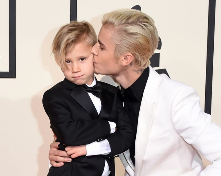 Singer Justin Bieber (R) and Jaxon Bieber attend The 58th GRAMMY Awards at Staples Center on February 15, 2016 in Los Angeles