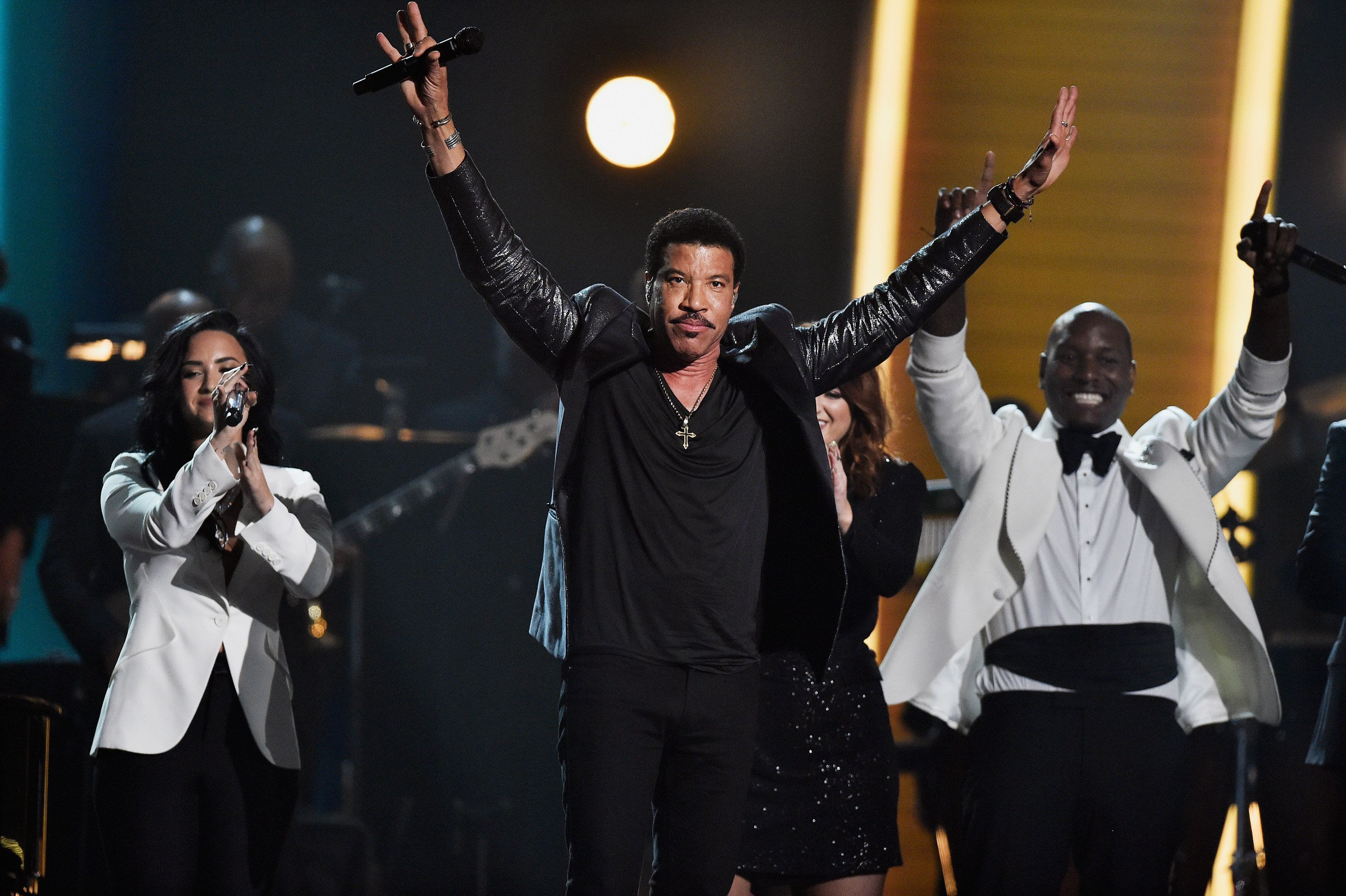 LOS ANGELES, CA - FEBRUARY 15:  (L-R) Singers Demi Lovato, Lionel Richie and Tyrese Gibson perform onstage during The 58th GRAMMY Awards at Staples Center on February 15, 2016 in Los Angeles, California.  (Photo by Kevork Djansezian/Getty Images for NARAS)