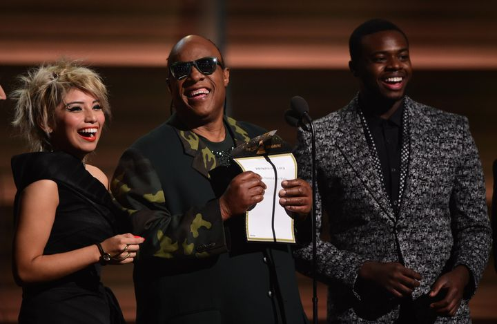 Musician Stevie Wonder (C) and Pentatonix present the Song of the Year on stage during the 58th Annual Grammy music Awards in