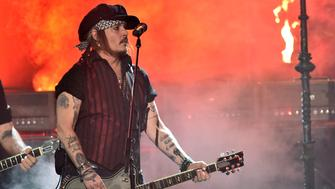 LOS ANGELES, CA - FEBRUARY 15:  Guitarist Johnny Depp of music group The Hollywood Vampires performs onstage during The 58th GRAMMY Awards at Staples Center on February 15, 2016 in Los Angeles, California.  (Photo by Kevin Winter/WireImage)