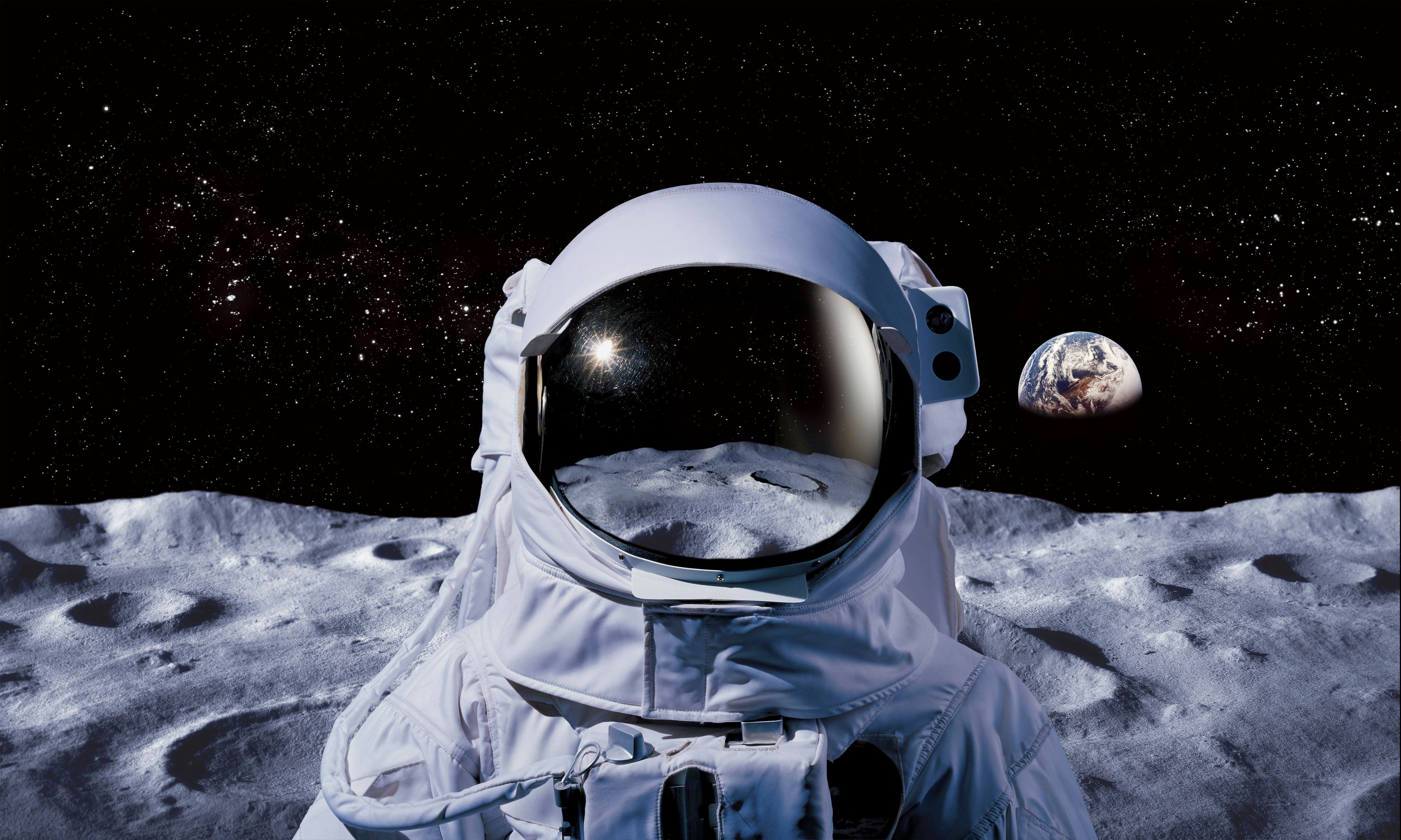 Astronaut on moon with earth in background