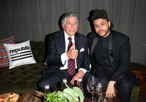 Recording artists Tony Bennett (L) and The Weeknd attend the Republic Records Grammy Celebration.