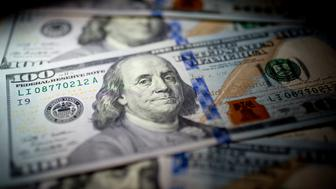 U.S. $100 bills are arranged for a photograph in Washington, D.C., U.S., on Thursday, Feb. 6, 2014. A suspension of the federal debt limit, enacted by Congress in October, is scheduled to expire Feb. 7. Treasury Secretary Jacob J. Lew has urged lawmakers to act quickly to raise the cap, saying the government's ability to meet its obligations will run out before the end of this month. Photographer: Andrew Harrer/Bloomberg via Getty Images