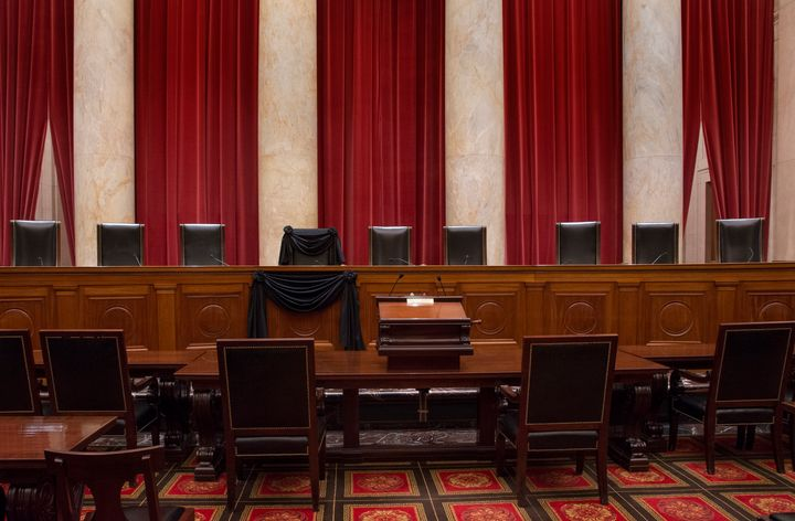 Justice Antonin Scalia's bench chair and the bench in front of his seat are draped in black to commemoratehis death on