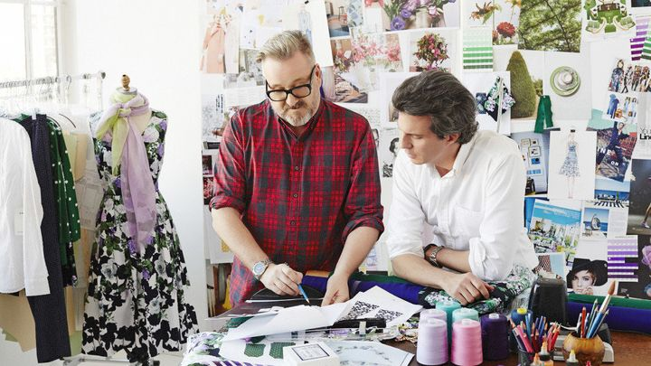 Leon Green, Talbots senior vice president of apparel and design, and O creative director Adam Glassman confer over sketches.