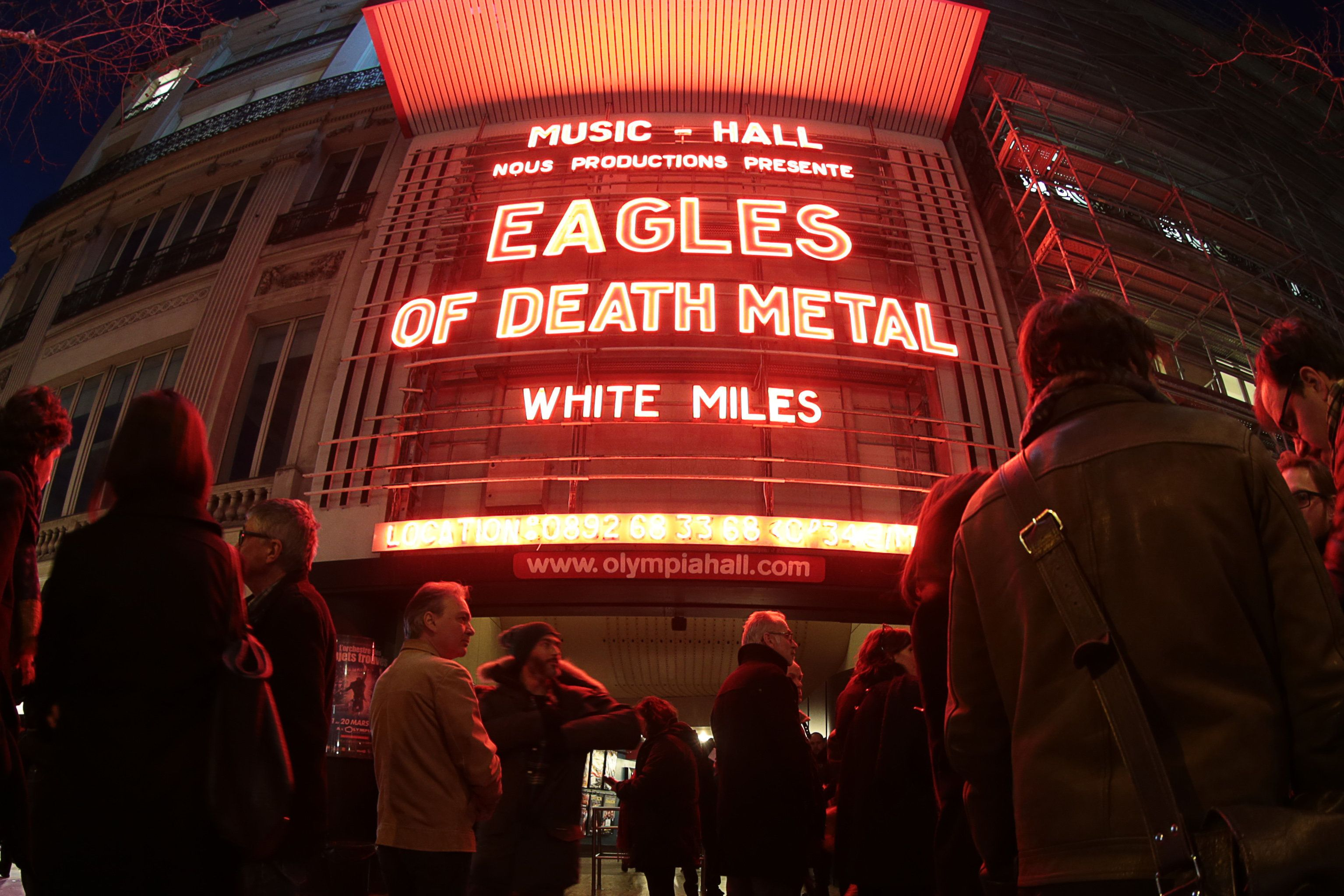 A picture taken with a fisheye lens shows people standing outside the Olympia concert venue in Paris, a few hours ahead of a concert by US rock group Eagles of Death Metal, on February 16, 2016. Eagles of Death Metal, the Californian rock group who were playing at the Bataclan music hall in Paris when jihadist gunmen burst in and killed 90 people in November, returned to the French capital for a concert at the Olympia. AFP PHOTO / JOEL SAGET / AFP / JOEL SAGET        (Photo credit should read JOEL SAGET/AFP/Getty Images)
