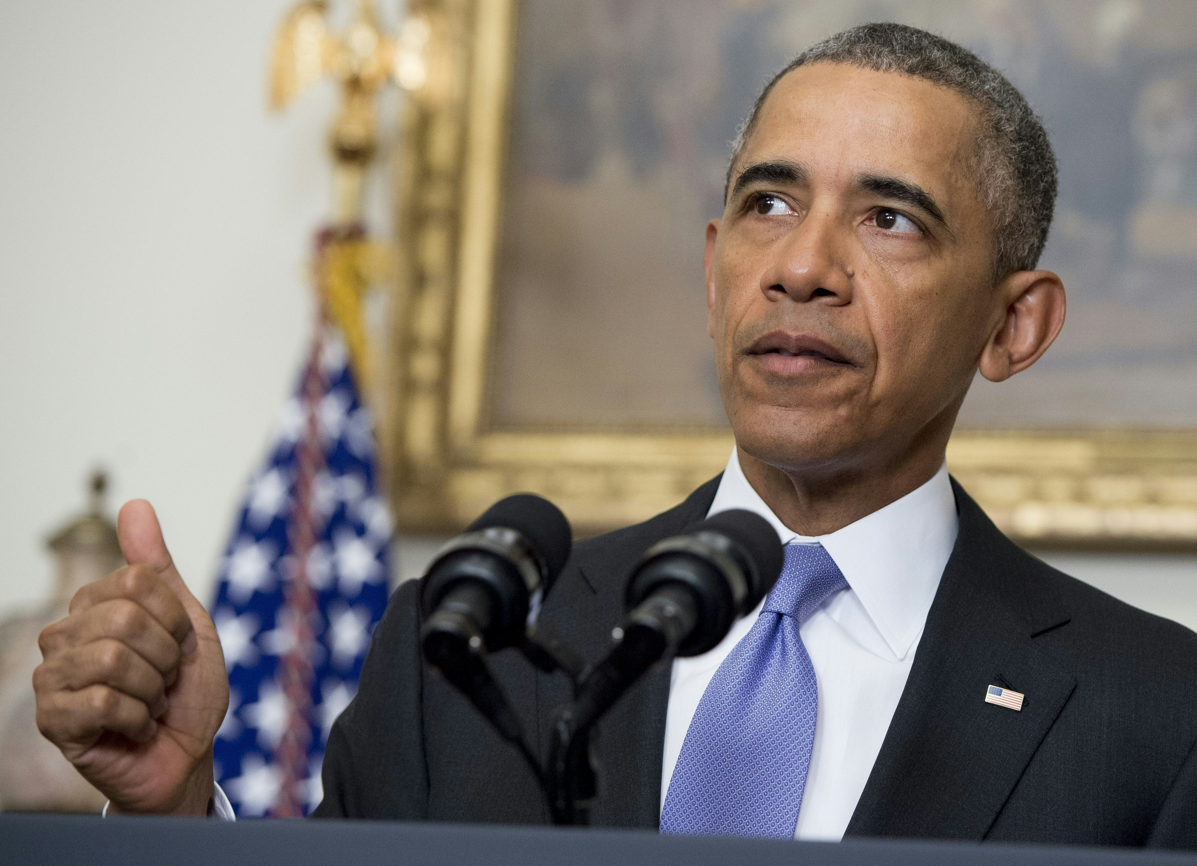 US President Barack Obama speaks about US - Iranian relations, including the Iranian-American nationals that were jailed in Iran and are being freed as part of a prisoner swap, in the Cabinet Room of the White House in Washington, DC, January 17, 2016.  The presidential statement comes after the lifting of international sanctions against Iran as part of a nuclear deal capped by a US-Iranian prisoner exchange. / AFP / SAUL LOEB        (Photo credit should read SAUL LOEB/AFP/Getty Images)