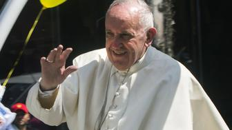 Pope Francis waves to the faithful upon his arrival in Morelia, Michoacán, on February 16, 2016.  Pope Francis arrived in Mexico's troublesome western state of Michoacan, where the cult-like Knights Templar drug cartel and its pseudo-messianic leader terrorized the population until farmers revolted against them.  AFP PHOTO/ENRIQUE CASTRO / AFP / ENRIQUE CASTRO        (Photo credit should read ENRIQUE CASTRO/AFP/Getty Images)