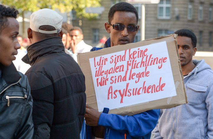 Eritreans are fleeing an authoritarian government and indefinite forced conscription. Here, a refugee from Eritrea holds