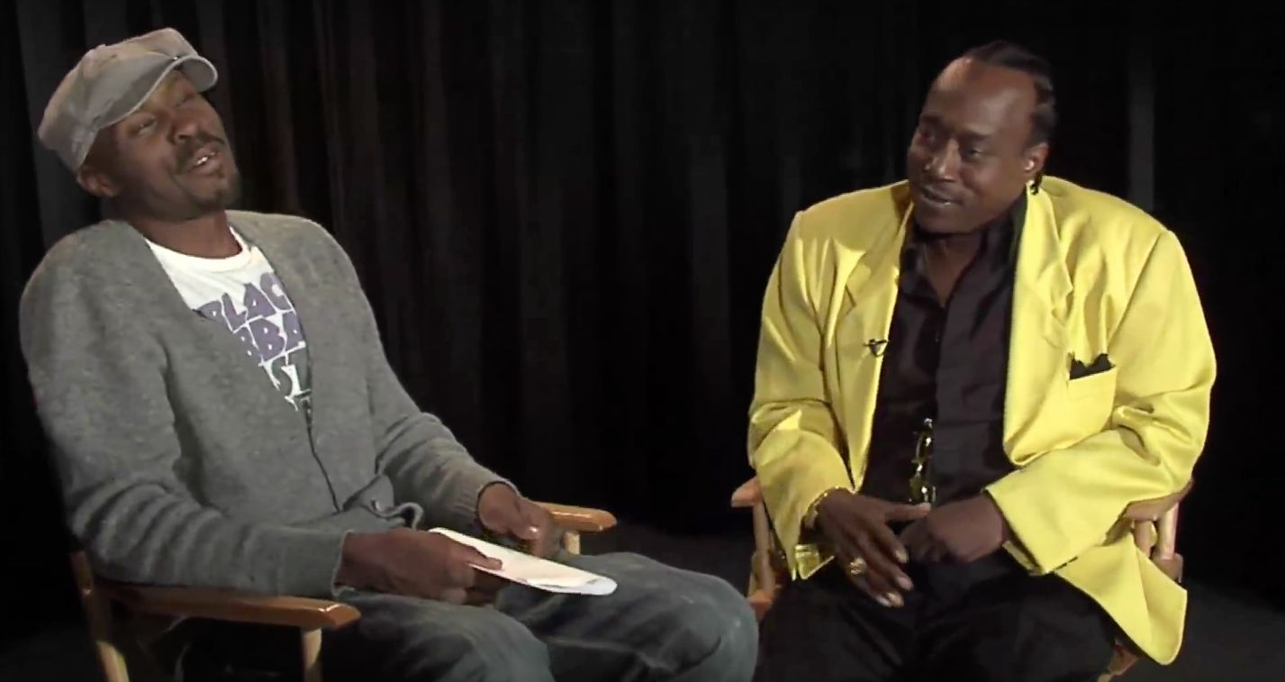 "Actor Wood Harris (left), who played drug kingpin Avon Barksdale on the HBO show ""The Wire,"" interviews former Baltimore"