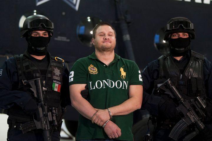 "Federal police present drug trafficker Edgar ""La Barbie"" Valdez Villarreal to the press, Aug. 31, 2010. Prosecutors plan to c"