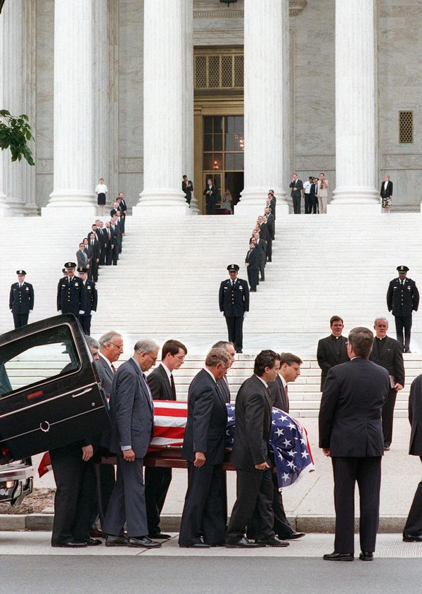 The body of former Justice William Brennan is carried out of the hearse before being taken into the Supreme Court o