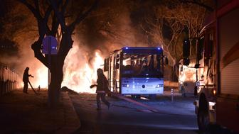 Firefighters try to extinguish flames following an explosion after an attack targeted a convoy of military service vehicles in Ankara on February 17, 2016.  At least five people were killed and 10 people were wounded in a car bombing in the Turkish capital Ankara on February 17, the city's governor said. The attack targeted a convoy of military service vehicles, Ankara governor Mehmet Kiliclar said, quoted by the CNN-Turk and NTV channels.  / AFP / STRINGER        (Photo credit should read STRINGER/AFP/Getty Images)