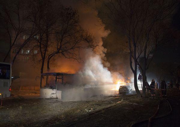 Smoke rises from a burning bus on Merasim Street.