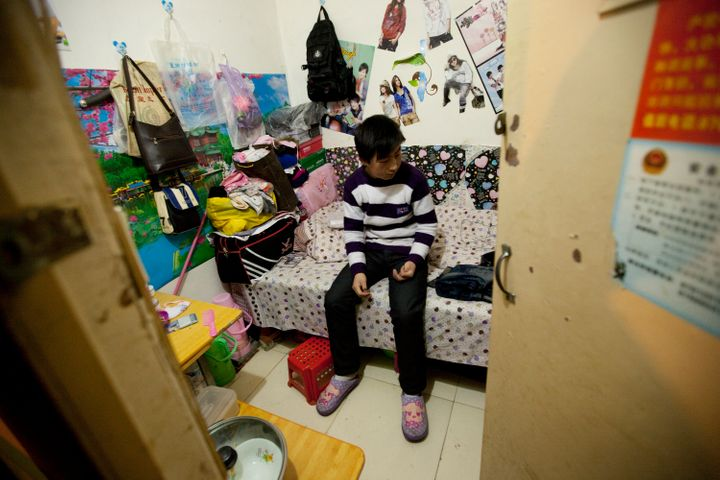 A man sits inside his apartment inside a Chinese air defense bunker onthe outskirts of Beijing, China, on Friday, Feb.