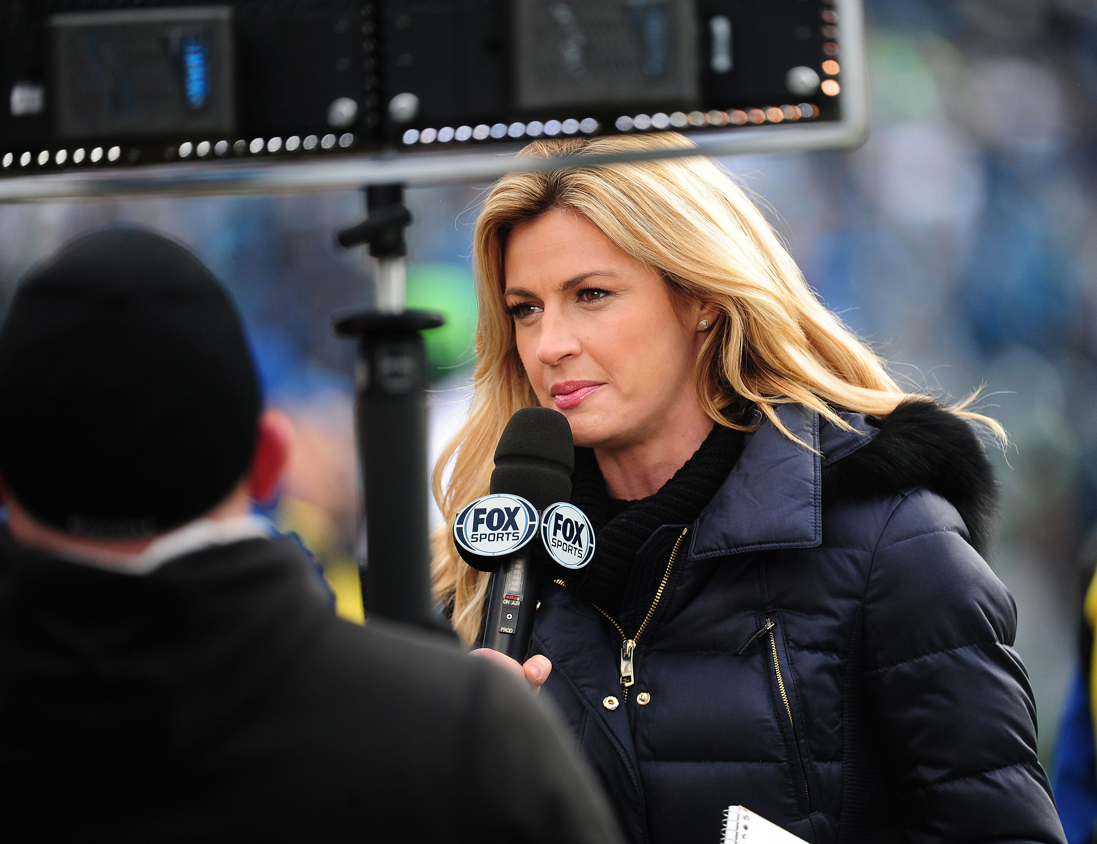 CHARLOTTE, NC - JANUARY 17: Fox Sports sideline reporter Erin Andrews gives an update during the NFC Divisional Playoff Game between the Carolina Panthers and the Seattle Seahawks at Bank Of America Stadium on January 17, 2016 in Charlotte, North Carolina. (Photo by Scott Cunningham/Getty Images)