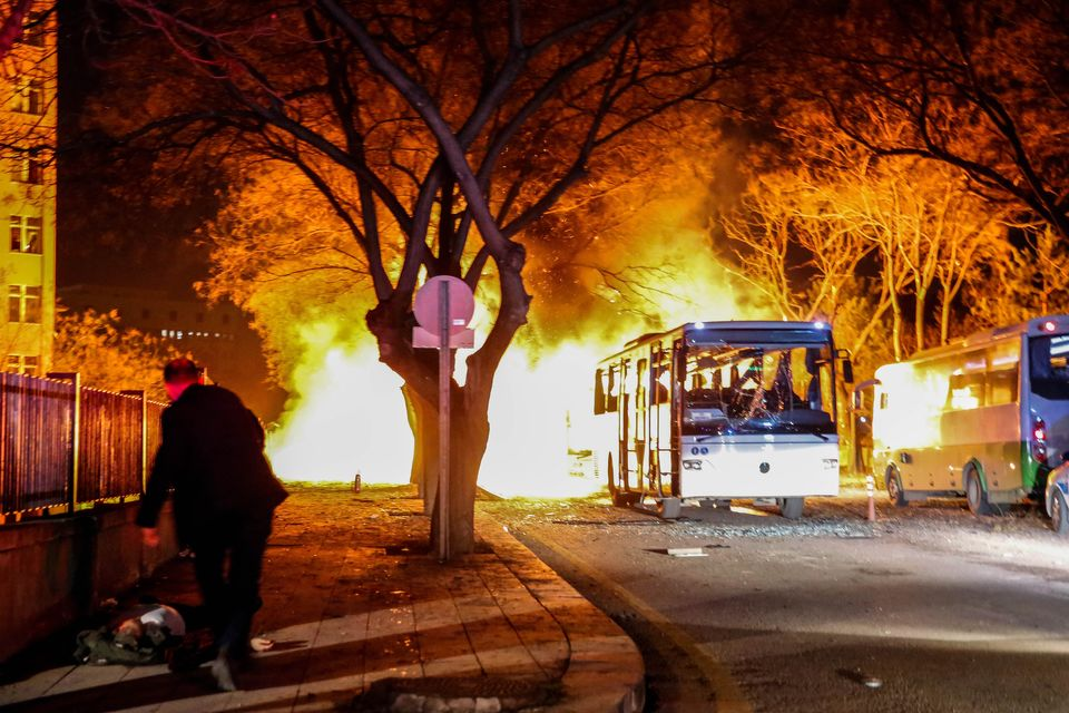 Buses burn following an explosion near government buildings in Ankara, Turkey, on Feb. 17.