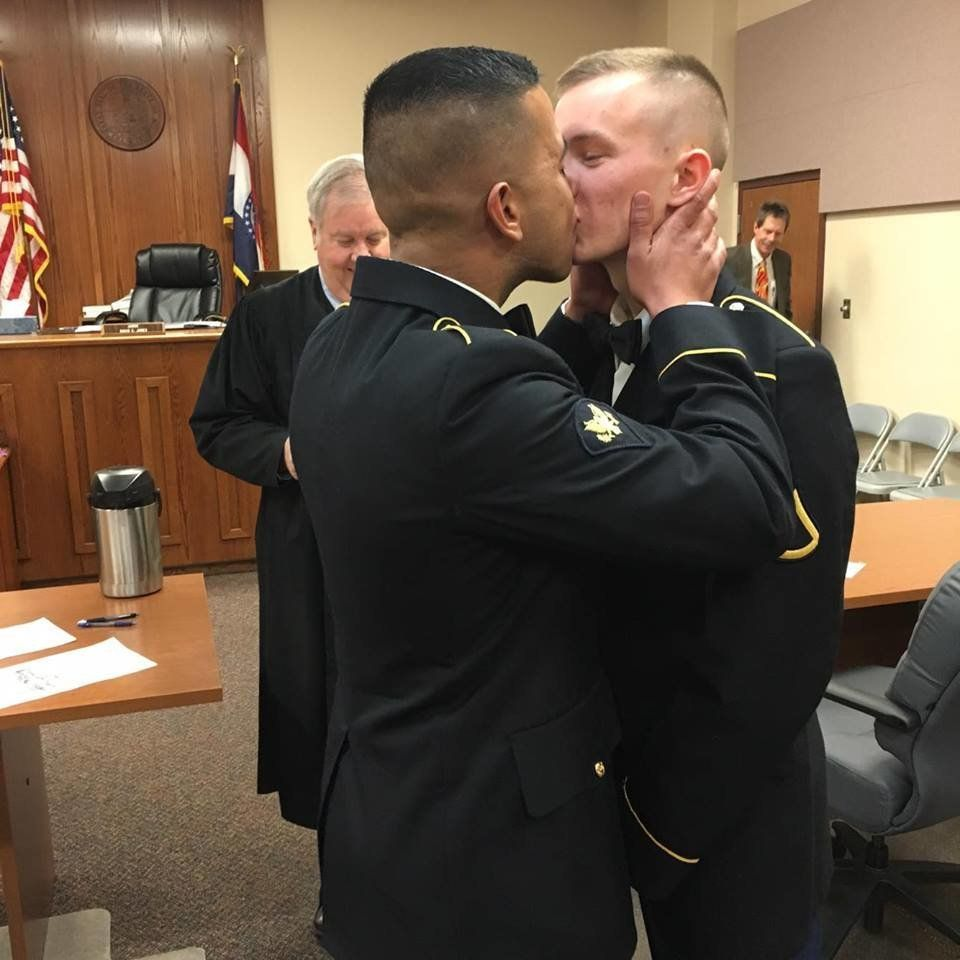 Uniform gay men kiss photo