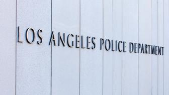 Metal lettering on a wall depicting the headquarters of the Los Angeles Police Department.