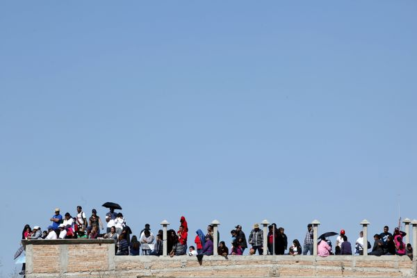 People wait for Pope Francis to drive pass to the CeReSo n. 3 penitentiary in Ciudad Juarez, Mexico Feb. 17, 2016.