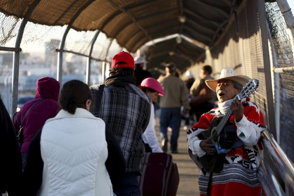 People coming from El Paso, United States, are serenaded as they cross the border bridge between Mexico and the U.S., to atte