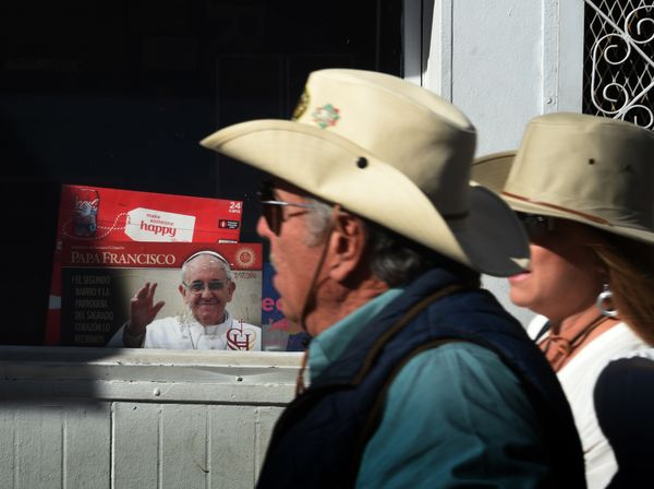 U.S. citizens walk towards the border crossing into Mexico where they will attend the mass and blessing where Pope Francis wi