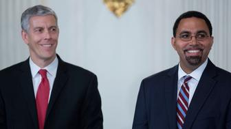 John King Jr., senior advisor at the U.S. Department of Education, right, and Arne Duncan, U.S. education secretary, smile during a news conference with U.S. President Barack Obama, not pictured, in the State Dining Room of the White House in Washington, D.C., U.S., on Friday, Oct. 2, 2015. Obama announced that Education Secretary Arne Duncan is stepping down in December and will be replaced by Deputy Secretary John B. King Jr. Photographer: Andrew Harrer/Bloomberg via Getty Images