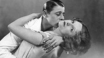 English actress Adrianne Allen in the arms of actor Patrick Suzande in a scene from the show 'Always Afternoon' at London's Lyric Theatre.