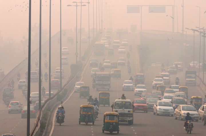 People commute amid smog on Nov. 3, 2015, in New Delhi. Such pollution is largely responsible for record-high temperatures se