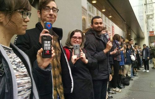 Dozens of protestors stand in solidarity with Apple outside the company's flagship store in San Francisco.