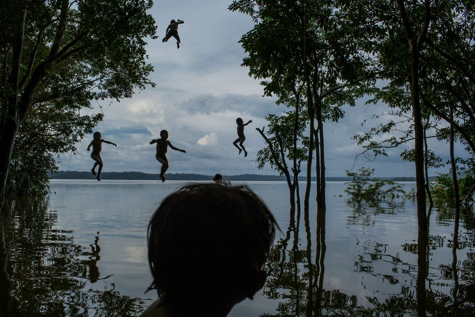 Indigenous Munduruku children play in the Tapajos river in the tribal area of Sawre Muybu, Itaituba, Brazil on Feb. 10, 2015.