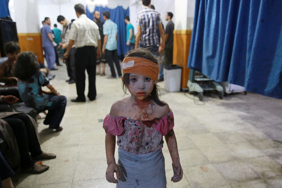A wounded Syrian girl at a makeshift hospital in Douma, Syria, on Aug. 22, 2015.