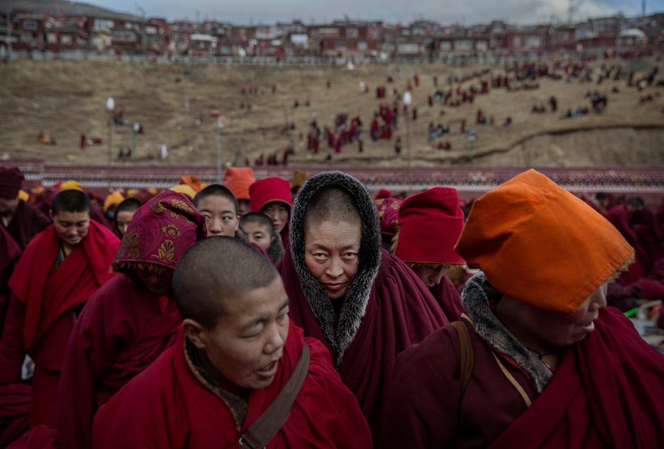 Tibetan Buddhist nuns stand following a chanting session in Sertar county, Garze Tibetan Autonomous Prefecture, Sichuan provi
