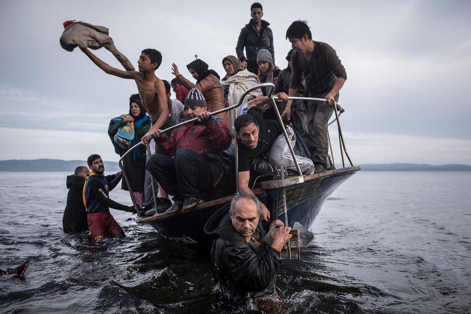 Refugees arrive by boat near the village of Skala on Lesbos, Greece, Nov. 16, 2015.
