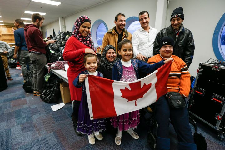 A Syrian refugee family arrives in Toronto. Canada vowed to resettle 25,000 Syrian refugees by the end of February, and the U