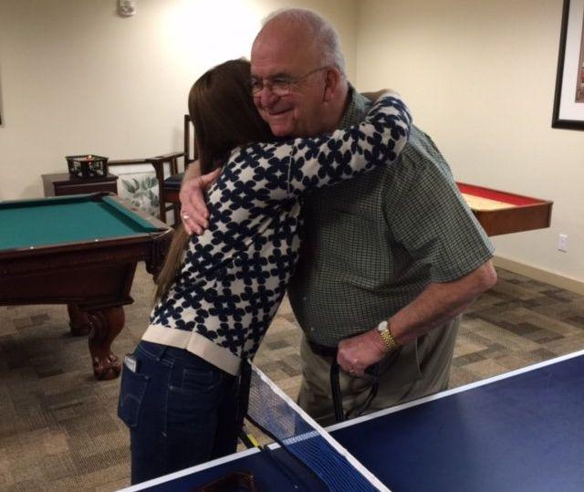 Jenkin's hugs a Deerfield resident.