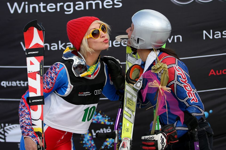 QUEENSTOWN, NEW ZEALAND - AUGUST 22:  (L-R) Second place Heather Mills of Great Britain kisses first place winner Melanie Sch