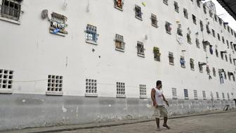 A prisoner walks at a pavilion of La Modelo prison in Bucaramanga, Colombia, on August 21, 2015. In a prison in the mountains of Colombia, a government program gathers former guerrillas and former paramilitaries, once mortal enemies and today demobilized, in order to prove that reconciliation is possible. AFP PHOTO / GUILLERMO LEGARIA        (Photo credit should read GUILLERMO LEGARIA/AFP/Getty Images)
