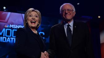 US Democratic presidential candidates Hillary Clinton and Bernie Sanders shake hands before participating in the MSNBC Democratic Candidates Debate at the University of New Hampshire in Durham on February 4, 2016.  Clinton and Sanders face off on February 4, in the first debate since their bruising Iowa clash that the former secretary of state won by a hair, as they gear for a battle royale in New Hampshire. / AFP / JEWEL SAMAD        (Photo credit should read JEWEL SAMAD/AFP/Getty Images)