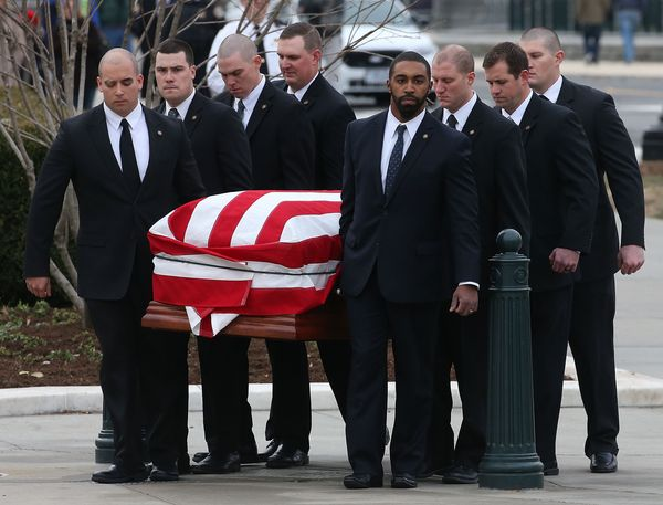 The casket of Associate Justice Antonin Scalia is carried by U.S. Supreme Court police officers, at the Supreme Court buildin