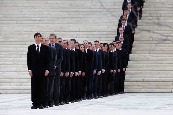 Law clerks line the stairs in front of the U.S. Supreme Court in anticipation of the arrival of Associate Justice Antonin Sca