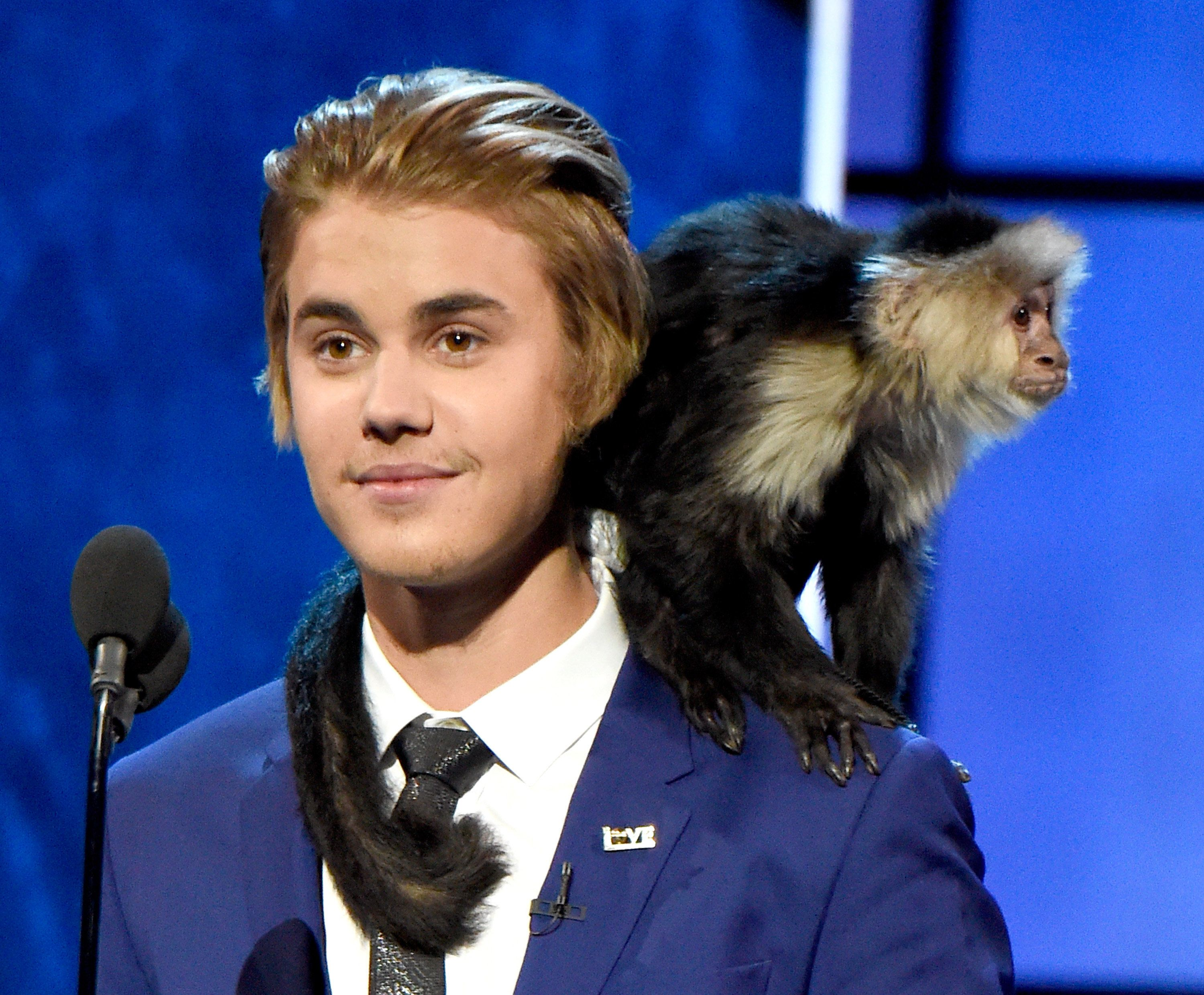 LOS ANGELES, CA - MARCH 14:  Honoree Justin Bieber and his monkey speak onstage at The Comedy Central Roast of Justin Bieber at Sony Pictures Studios on March 14, 2015 in Los Angeles, California. The Comedy Central Roast of Justin Bieber will air on March 30, 2015 at 10:00 p.m. ET/PT.  (Photo by Kevin Mazur/WireImage)