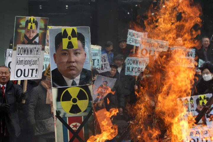 South Korean protesters burn an effigy of North Korea leader Kim Jong-Un during an anti-North Korea rally on February 11, 201