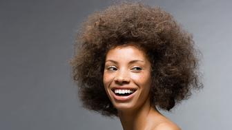 A2P3RJ Young woman with afro hairstyle
