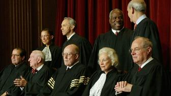 WASHINGTON - DECEMBER 5:  US Supreme Court Justices (L-R, Seated) Associate Justice Antonin Scalia, Associate Justice John Paul Stevens, Chief Justice William H. Rehnquist, Associate Justice Sandra Day O'Connor, Associate Justice Anthony M. Kennedy, (L-R, Standing) Associate Justice Ruth Bader Ginsburg, Associate Justice David H. Souter, Associate Justice Clarence Thomas and Stephen G. Breyer pose for pictures at the US Supreme Court December 5, 2003 in Washington, DC.  (Photo by Mark Wilson/Getty Images)