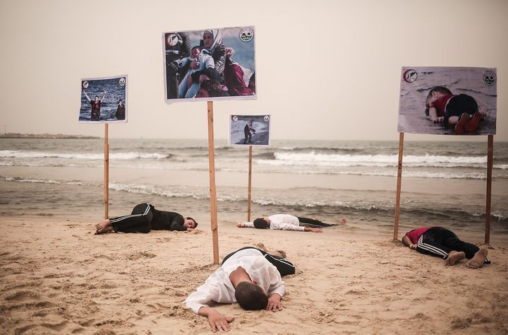 People lie on the Gaza beach to commemorate Alan Kurdi and 12 Syrians who drowned in the Aegean Sea after two boats filled wi